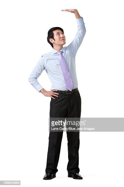 Businessman Carrying an Object Over His Head