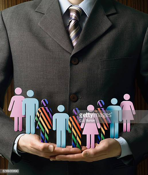 businessman carrying diverse group of people - loyalty stock pictures, royalty-free photos & images
