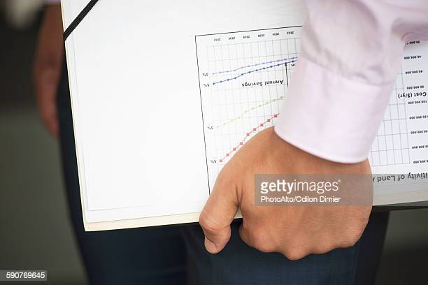 Businessman carrying documents under arm