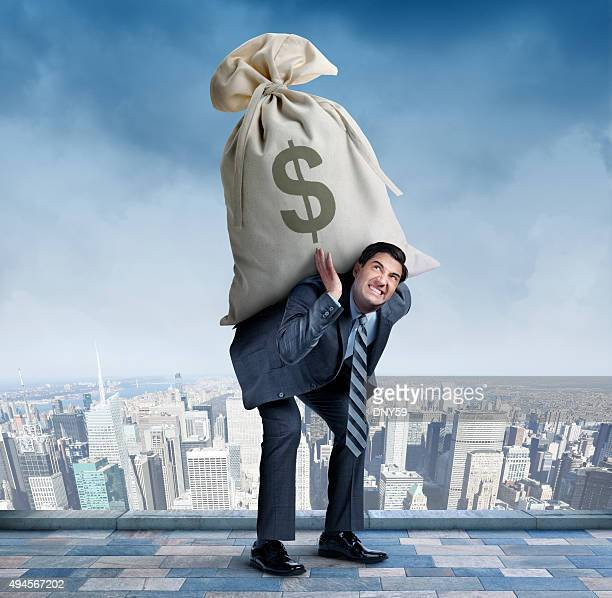 Businessman Carrying Large Money Bag