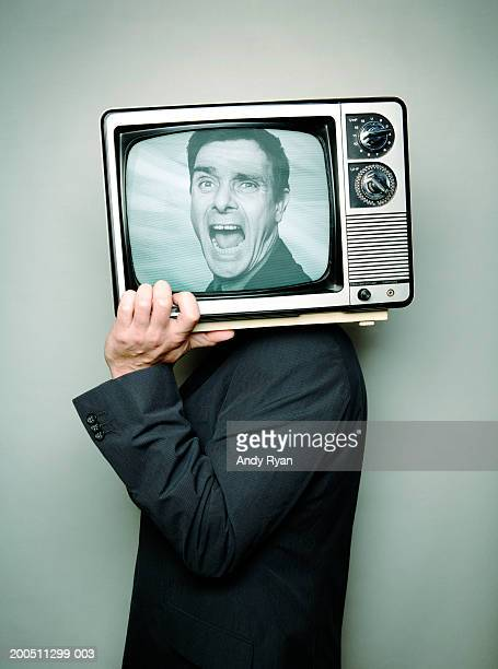 businessman carrying television on shoulder, face on screen, shouting - trapped stock pictures, royalty-free photos & images