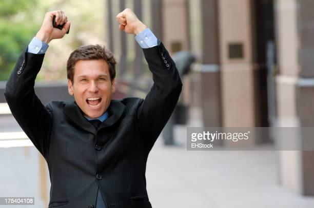 Businessman Celebrating Downtown Business District