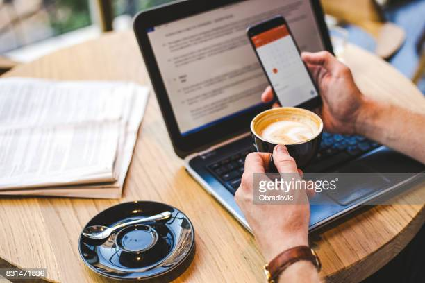 Businessman checking email on smartphone