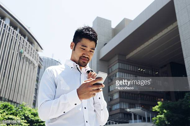 Businessman Checking Emails WIth Smart Phone