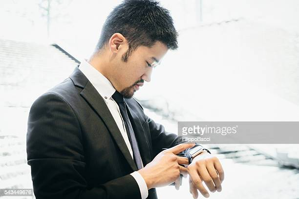 Businessman Checking Emails With Smart Watch