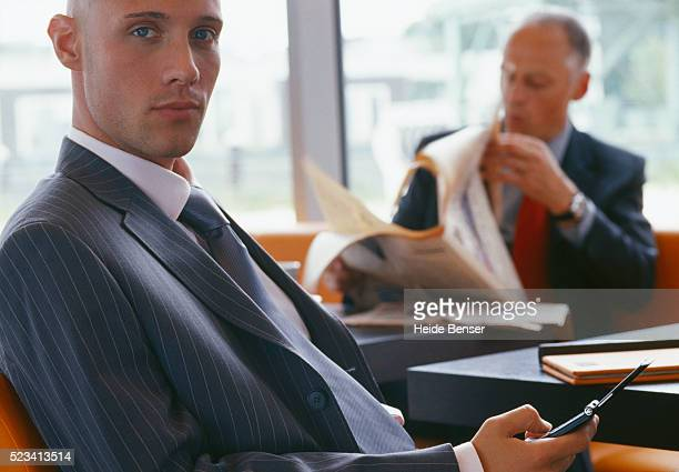 Businessman Checking His Cell Phone