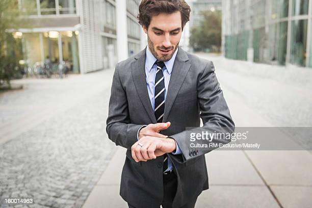 Businessman checking his watch
