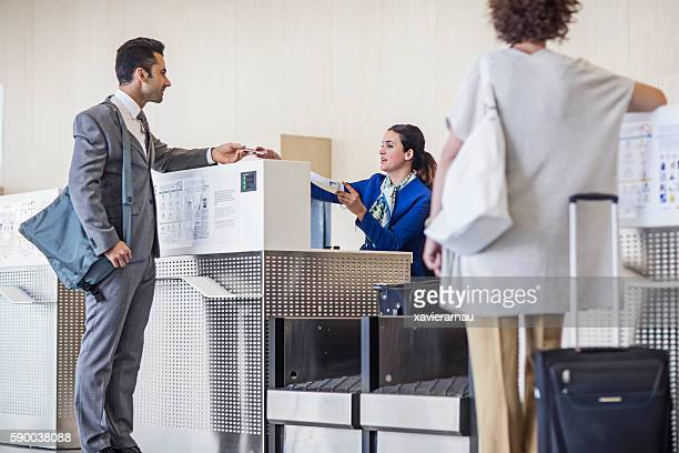 Businessman checking in at airport counter