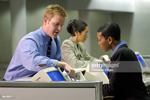 Businessman checking in at airport gate