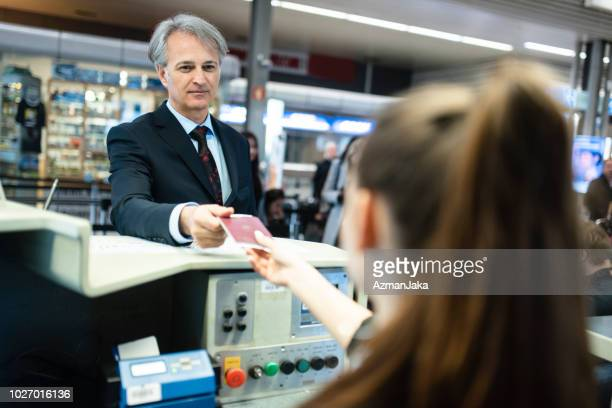 Businessman checking in at the counter