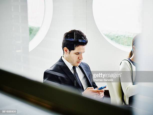 Businessman checking information on smartphone