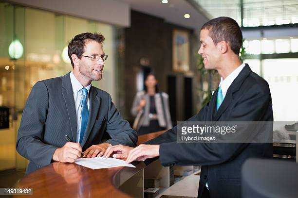 Businessman checking into hotel