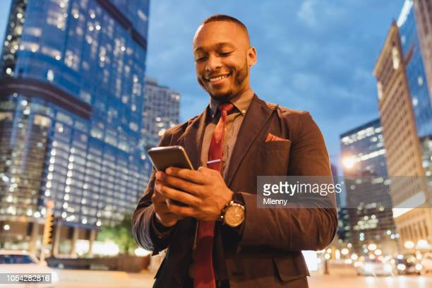Businessman checking messages on mobile phone in chicago