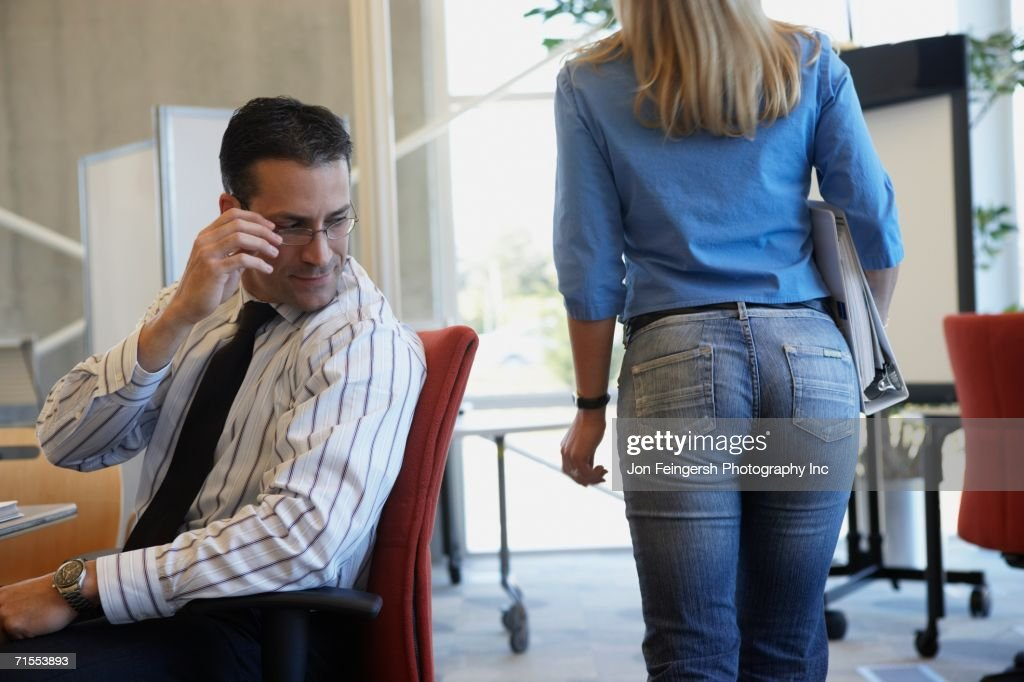 Businessman checking out female coworker : Stock Photo
