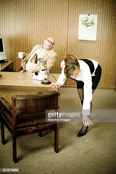 businessman checking out secretary in office - funny fat women stock pictures, royalty-free photos & images