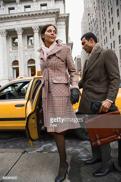 Businessman Checking Out Woman Getting Out of Taxi