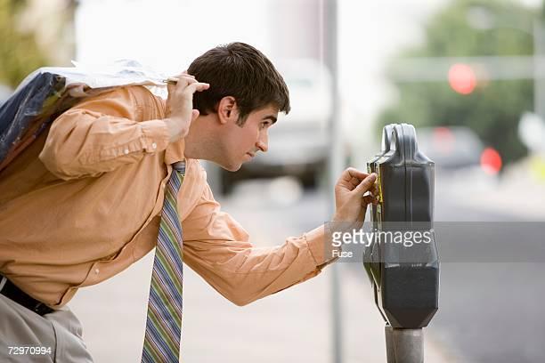 Businessman checking parking meter