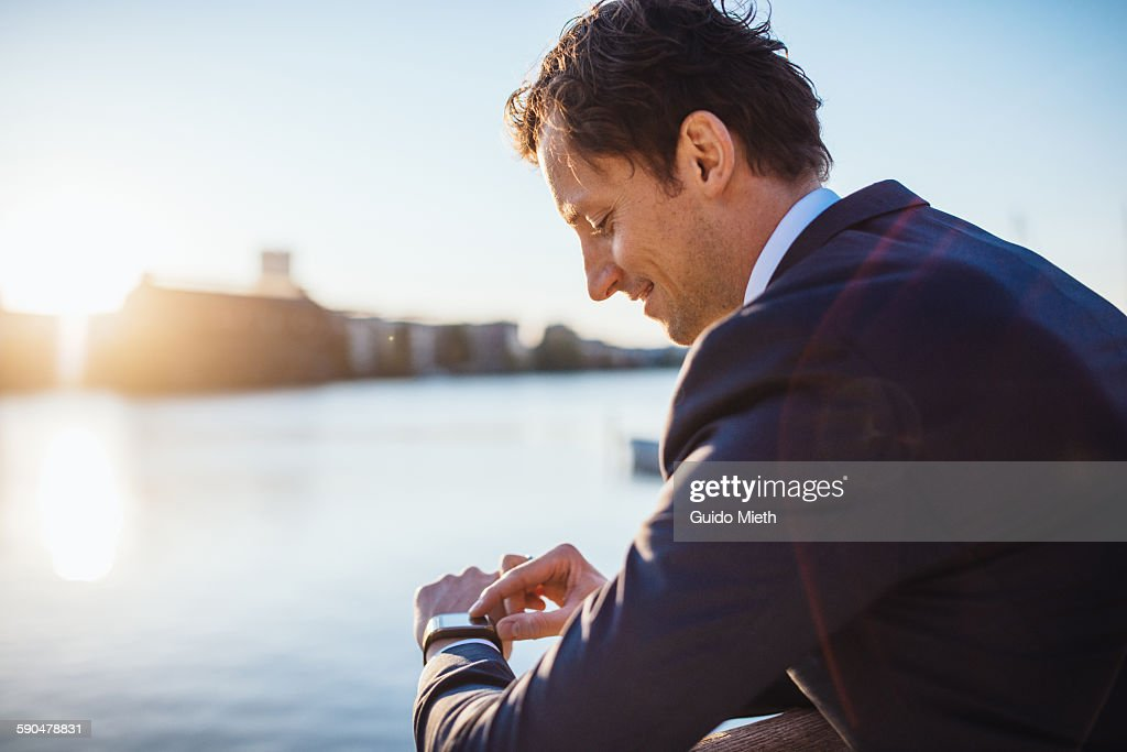 Businessman checking smartwatch. : Stock Photo