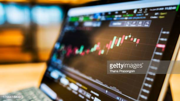 businessman checking stock market data. he using a mobile phone. analysis economy data on forex earn graph. - 国債 ストックフォトと画像
