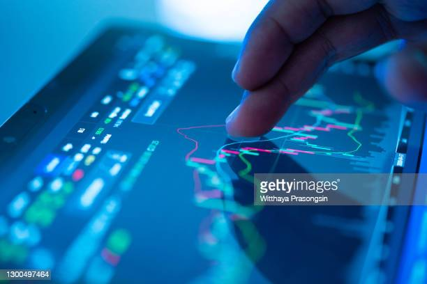 businessman checking stock market data - stock price stock pictures, royalty-free photos & images