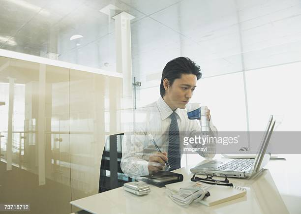 Businessman checking the laptop in the office