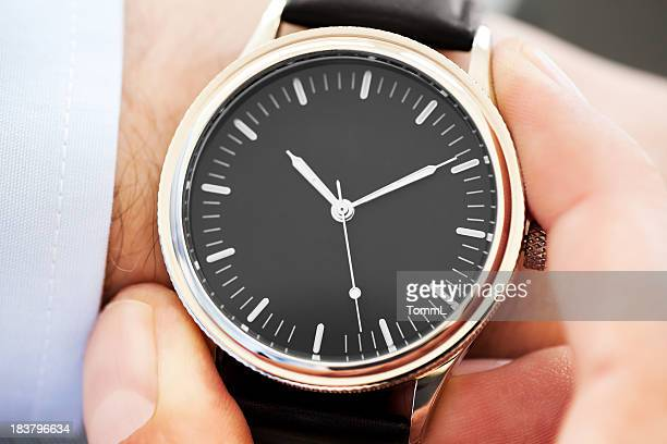 businessman checking time - wrist watch stock pictures, royalty-free photos & images