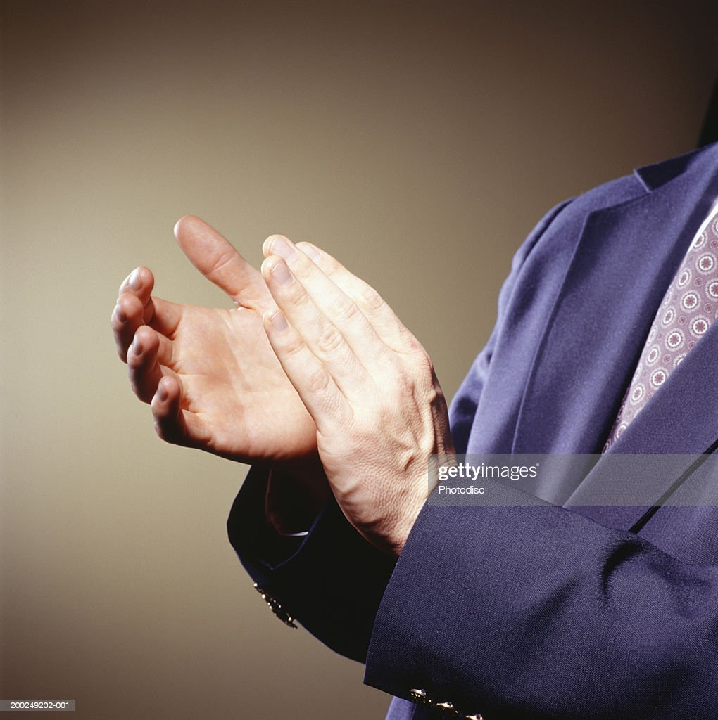 Businessman clapping, Close-up of hands : Stock Photo