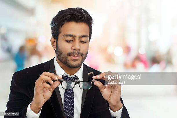 businessman cleaning glasses