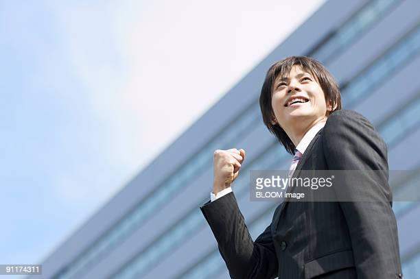 Businessman clenching fist