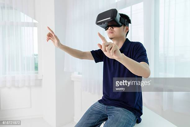 Businessman clicking with VR