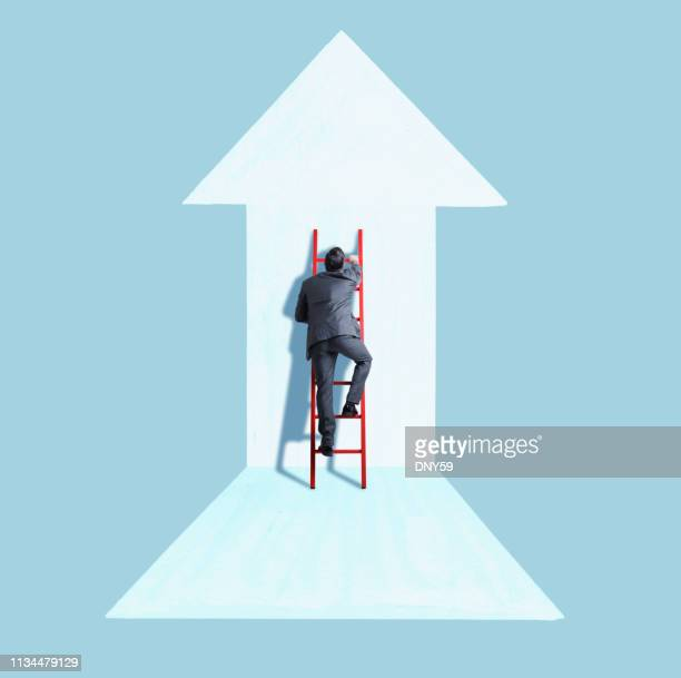 businessman climbing ladder following direction of arrow - following arrows stock pictures, royalty-free photos & images