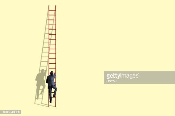 businessman climbing ladder - tall high stock photos and pictures