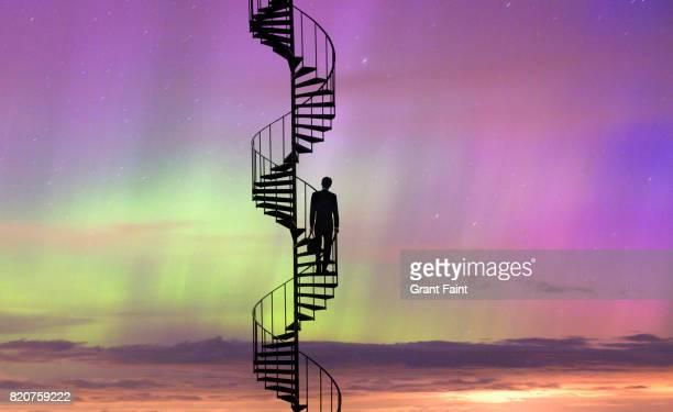 Businessman climbing staircase.