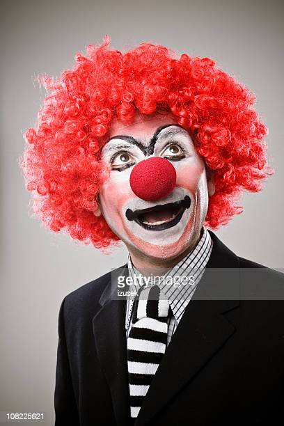 businessman clown - clown's nose stock photos and pictures