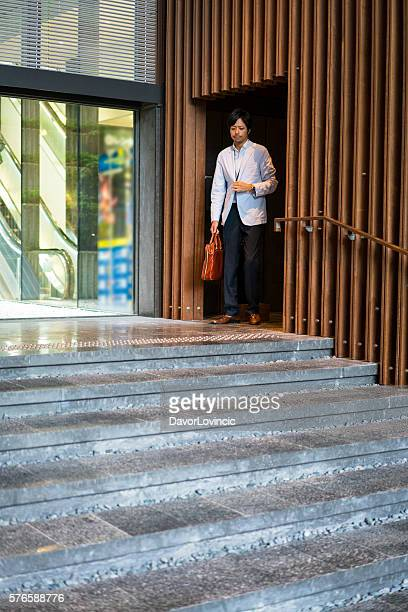 Businessman coming from meeting at office hall in Kyoto, Japan.