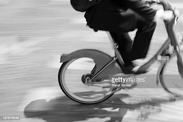 Businessman commuting on city bike in Paris, France