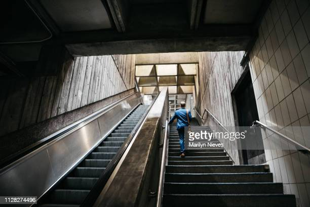businessman commuting - escalator stock pictures, royalty-free photos & images