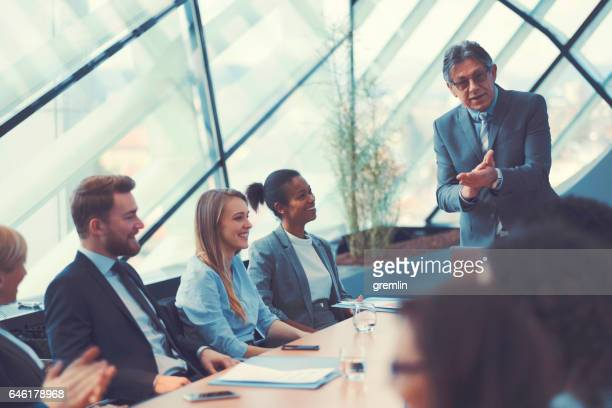 Businessman congratulating at the office meeting