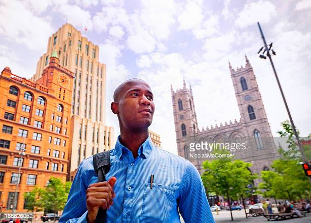 Businessman conquering Old Montreal