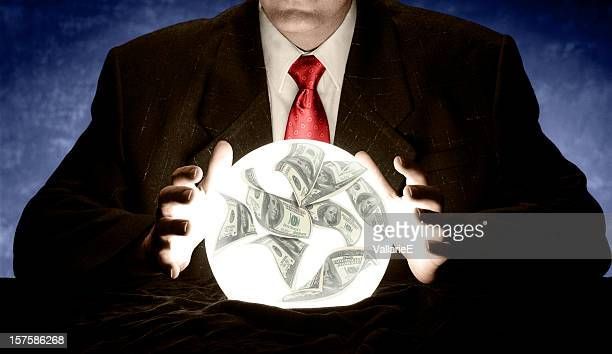 businessman consulting a glowing financial crystal ball - calculating stock pictures, royalty-free photos & images
