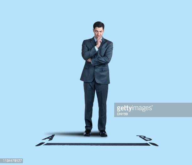 businessman contemplates the shortest distance between point a and point b - letra b imagens e fotografias de stock