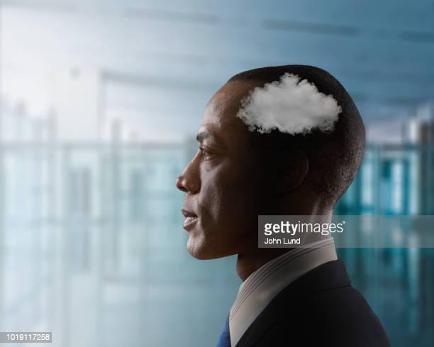 Businessman Contemplating Cloud Computing