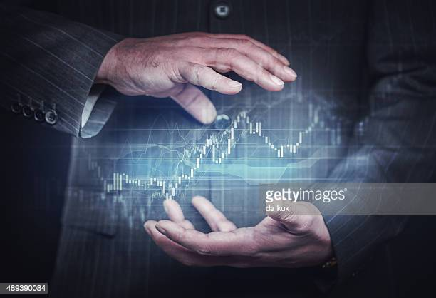 Businessman controlling financial charts