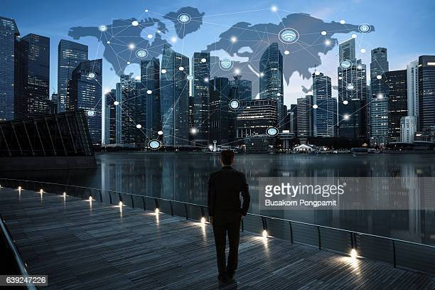 Businessman Corporate Cityscape Urban Scene City Building with network concept