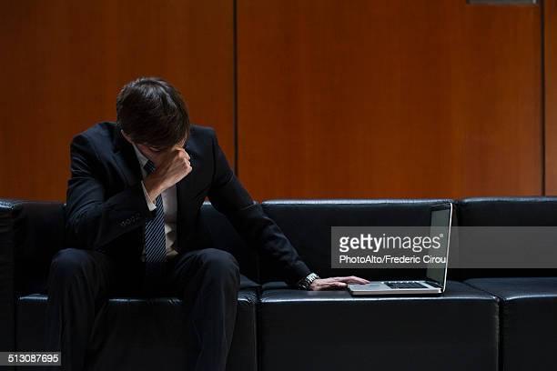 businessman covering eyes with hand in disbelief - börsencrash stock-fotos und bilder
