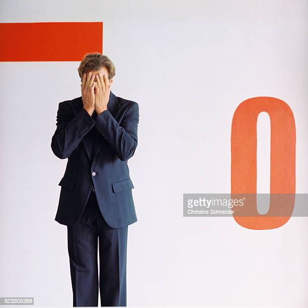 businessman covering face with hands - obscured face stock pictures, royalty-free photos & images
