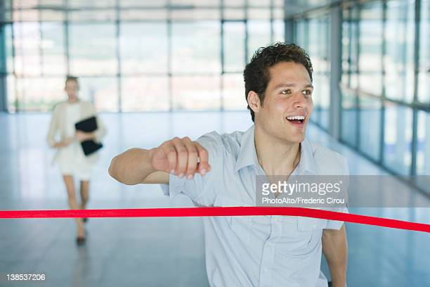 Businessman crossing finishing line