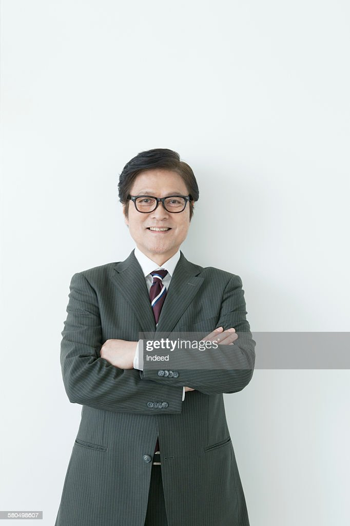 Businessman crossing his arms : Stock-Foto