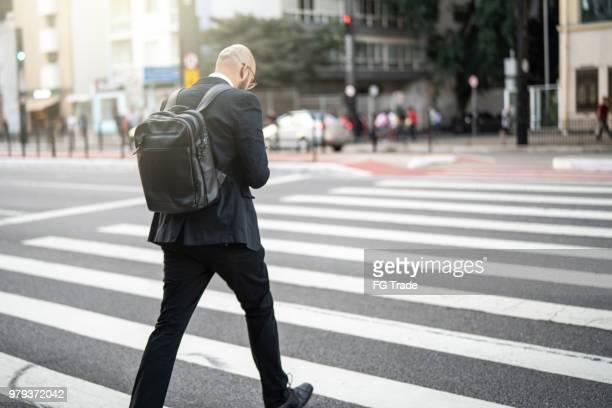 Businessman crossing Paulista Avenue, Sao Paulo, Brazil