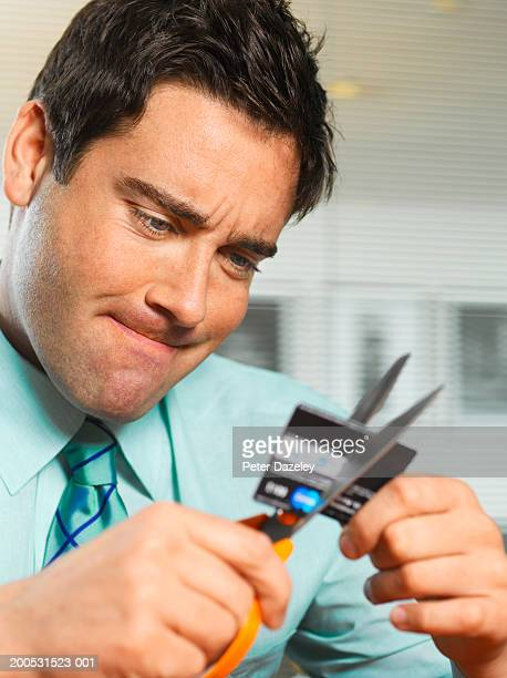 Businessman cutting up credit card, close-up
